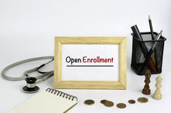 Doctor's working table with the frame and the text - Open Enroll Royalty Free Stock Image