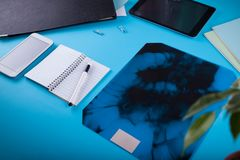 Doctor`s workspace. Roentgen image of intestines. Doctor`s workspace. Roentgen image of intestines on blue background Stock Photo