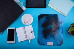 Doctor`s workspace. Roentgen image of intestines. Doctor`s workspace. Roentgen image of intestines on blue background Royalty Free Stock Images