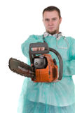 Doctor with saw Stock Photo