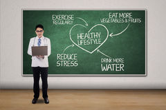 Doctor with scheme for healthy lifestyle stock image
