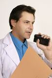 Doctor or scientist dictating Stock Image