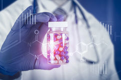 Doctor scientist invented new drug, holds capsule in hands Stock Photography