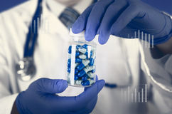 Doctor scientist invented new drug, holds capsule in hands Royalty Free Stock Photos
