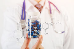 Doctor scientist invented new drug, holds capsule in hands Royalty Free Stock Photography