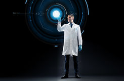 Doctor or scientist with virtual projection. Science, future technology and people concept - doctor or scientist in white coat over black background with virtual Royalty Free Stock Photos