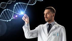 Doctor or scientist in white coat with dna. Science, genetics and people concept - doctor or scientist in white coat with dna molecule projection over black royalty free stock photos