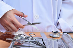Doctor with scissors Stock Photography