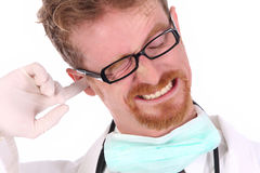 Doctor scratching on ear Stock Photos