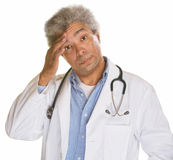 Doctor Scratching Forehead Stock Images