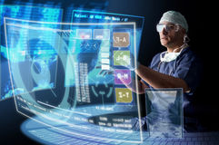 Doctor with screens Stock Images