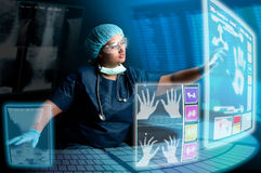 Doctor with screens Stock Photography