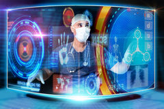 Doctor with screens Stock Image