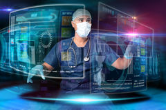 Doctor with screens Stock Photos