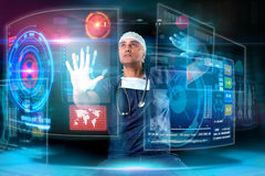 Doctor with screens Stock Photo