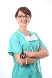 Doctor in scrub with stethoscope. Female doctor wearing green scrubs holding a stethoscope stock image