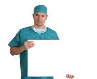 Doctor in scrubs with blank board Royalty Free Stock Image