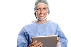 Doctor in scrubs entering data on a tablet Royalty Free Stock Images
