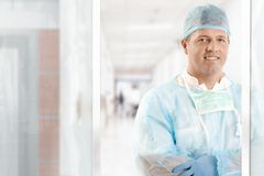 Doctor in scrubs. Male doctor in scrub suit smiling at hospital Royalty Free Stock Image