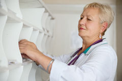 Doctor searching medical chart in clinic Royalty Free Stock Photography