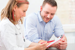 Doctor seeing patient in practice Royalty Free Stock Image