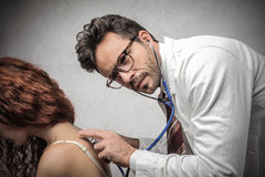 Doctor seeing a patient Stock Image