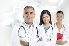 Doctor senior gray hair two nurses hospital Royalty Free Stock Photos