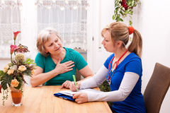 Doctor and senior have a conversation. Young doctor and senior have a conversation Royalty Free Stock Image