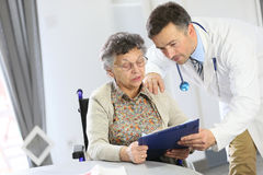 Doctor and senior lady discussing health Royalty Free Stock Image
