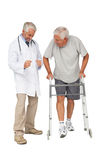 Doctor with senior man using walker Royalty Free Stock Photo