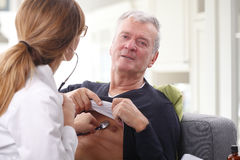 Doctor and senior patient stock images