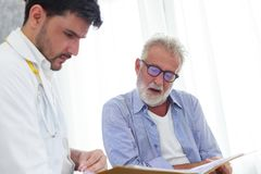 Doctor and senior patient discussing in health data. Healh care and medical concept consultation between doctor and patient Stock Photography