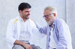 Doctor and senior patient discussing in health data. Doctor is using a stethoscope to check heart of senior patient. Healh care and medical concept consultation Royalty Free Stock Images