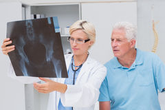 Doctor and senior patient examining x-ray Royalty Free Stock Photos
