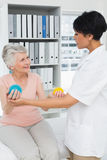Doctor with senior patient using stress buster balls Royalty Free Stock Photo