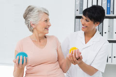 Doctor with senior patient using stress buster balls Royalty Free Stock Images