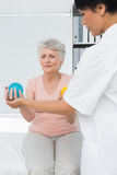 Doctor with senior patient using stress buster balls Royalty Free Stock Photography