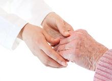 Doctor and Senior's Hands Stock Images