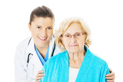Doctor And Senior Woman Against White Background Royalty Free Stock Photo