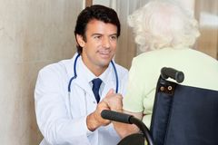 Doctor With Senior Woman In Wheel Chair Stock Images