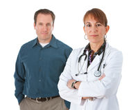 Doctor: Serious Doctor with Patient Behind stock images
