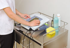Doctor while setting up ultrasound machine Royalty Free Stock Photos