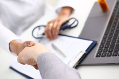 Doctor shake hand as hello with patient Stock Photos