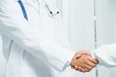 Doctor shakes hand with another doctor, teamwork Royalty Free Stock Photos