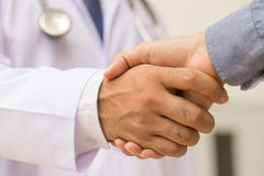 Doctor shakes hands with a patient Royalty Free Stock Image