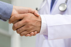 Doctor shakes hands with a patient Stock Photography