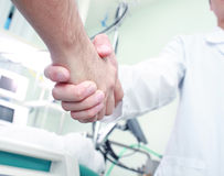 The doctor shakes hands with a patient Stock Photography