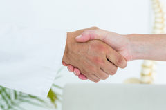 Doctor shaking hand of his patient Royalty Free Stock Images