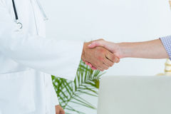 Doctor shaking hand of his patient Royalty Free Stock Photos