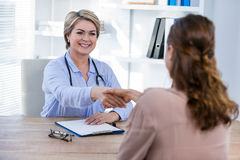 Doctor shaking hands with patient Royalty Free Stock Photography